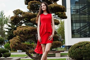 Teenage girl in red dress posed outd