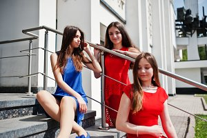 Three teenagers girl in blue and red