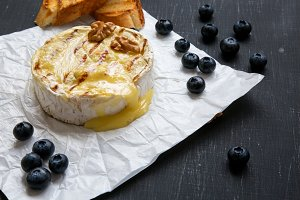 Grilled camembert cheese in paper