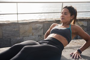 A fit young woman doing stomach crun