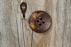 Old button on vintage wood