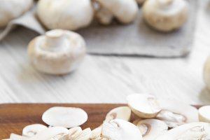 Chopped mushrooms on wooden chopping