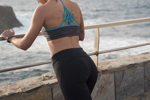 A woman in active wear standing by t