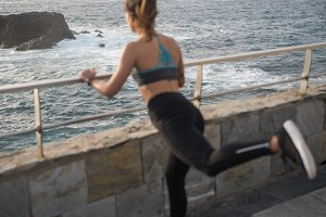 Back view of a woman exercising by t