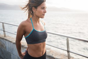 Pretty sporty woman in exercise clot