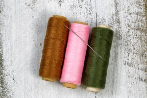 Spools of thread with needle