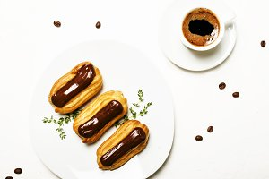 Eclairs cakes and morning espresso c