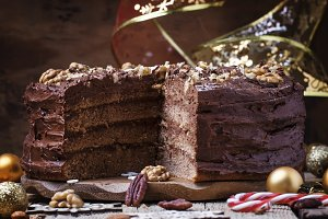 Sliced New Year chocolate cake with