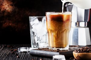 Summer cold coffee with ice and milk