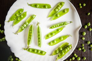 Pods of roasted peas on a plate