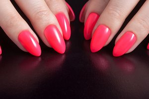Women's hands with red manicure