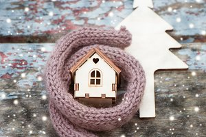 Toy house is wrapped in a warm scarf