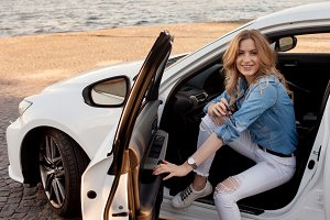woman sitting in a white car