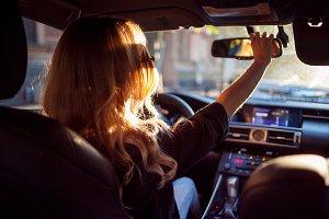 woman in sunglasses sitting in car