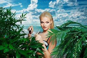 woman with sunglasses in blue bikini