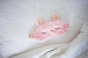 Sleeping mask on the bed.