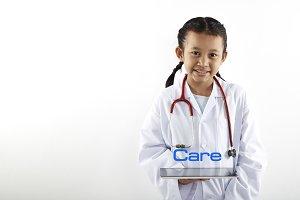Cute Asian little girl in doctor cos