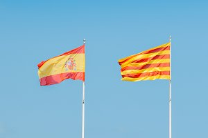 Catalonian and Spanish flags flying