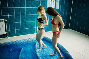 Two sexy girls in swimsuit having re