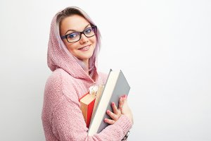 Student. Young woman with books.