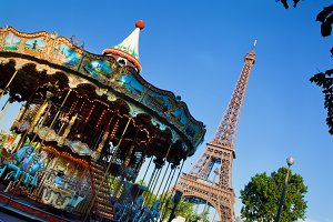 Vintage carousel agaist Eiffel Tower
