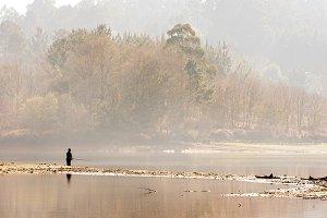 fisherman in the lake at sunrise
