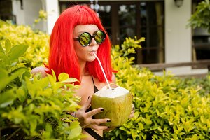 Girl with red hairs drink cold cocon