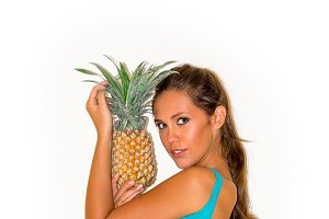 Young beautiful girl with pineapple.