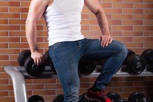 Muscular man stands near the counter