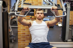 Man exercising at gym. Fitness