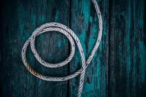Nautical Rope Against a Green Wooden
