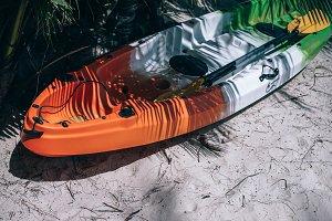 Orange White and Green Kayak