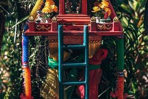 Red Thai Shrine with Blue Ladder