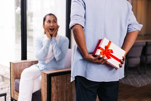 Middle aged husband hiding a surpris
