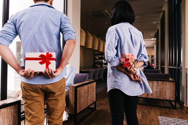 Two friends hiding a surprise gift…