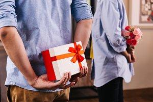 Two friends hiding a surprise gift a