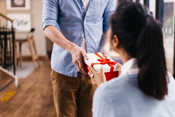 Boyfriend giving a surprise gift to…