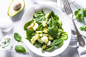 Green salad with avocado, spinach