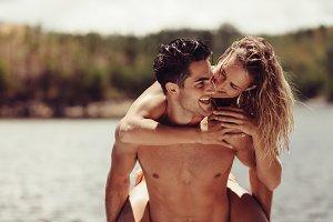 Romantic man piggybacking