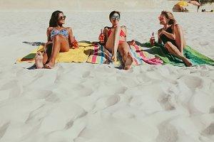Girlfriends sunbathing on beach