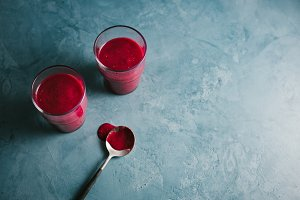 Red fruity smoothie in glasses