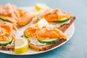 Salmon sandwiches served on plate