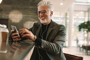 Mature businessman using phone