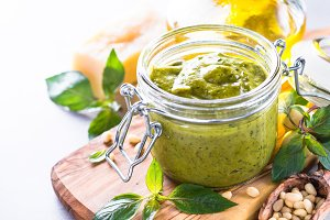 Pesto sauce in glass jar and