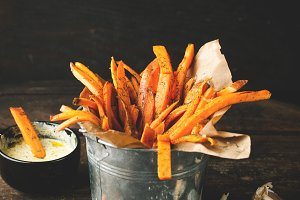 Sweet fried potatoes with spices, sa