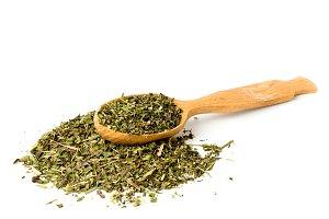 Green tea in wooden spoon