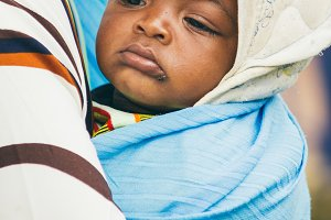 African baby with a fly