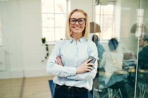 Smiling businesswoman standing with