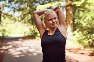 Fit young blonde woman stretching be