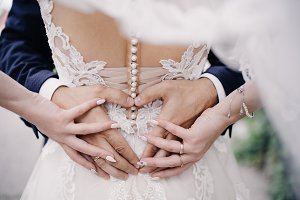 heart, hands and wedding rings